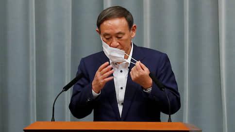 Из генсеков в премьеры // Ветеран японской партии власти дослужился до кресла премьер-министра
