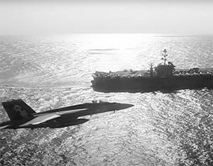 Появилось видео пролета российского Ил-38 рядом с американским авианосцем